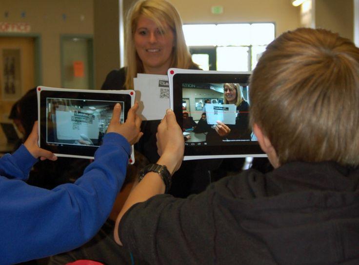 Saghalie teacher Kelsey Alig holds QR codes for students to photograph ...