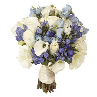 Bouquet of white roses, blue Gentians, pale blue delphiniums and white calla lilies