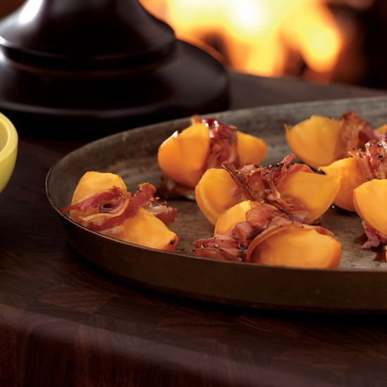Roasted Persimmons Wrapped in Pancetta // More Appetizer Recipes and Tips: http://www.foodandwine.com/cooking_guides/appetizer-recipes #foodandwine
