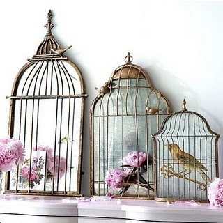 Bird cage mirrors: Ornate mirrors set in a bird cage