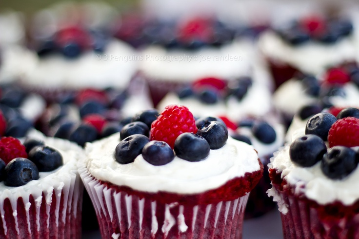 Red Velvet cupcakes with blueberries and raspberries.