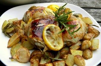 Roasted chicken thighs with potatoes, garlic, lemon and rosemary.