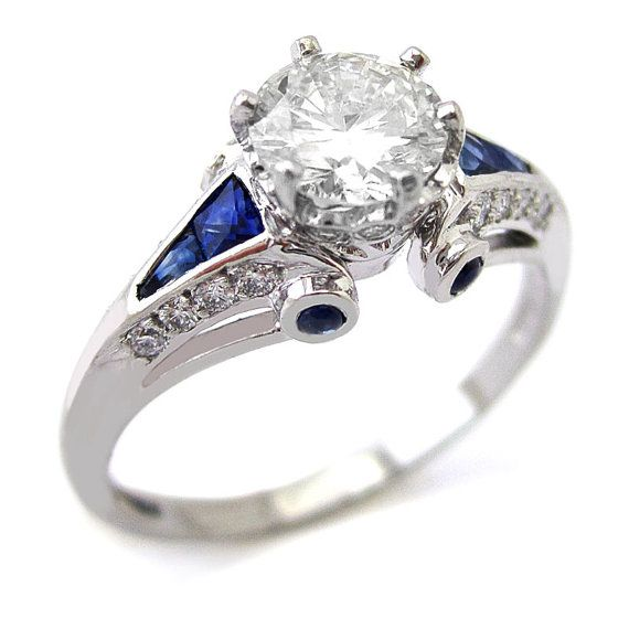 Round cut antique style diamond engagement ring with sapphire accents…