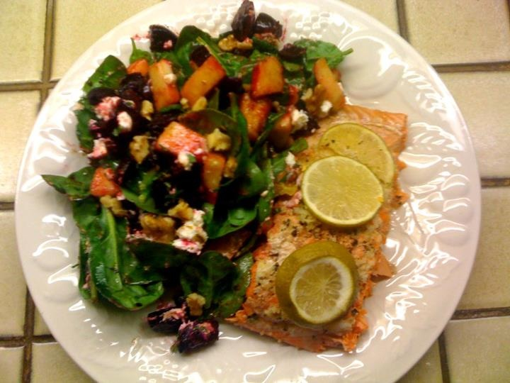Sockeye salmon served with a spinach salad with roasted beets, juicy ...
