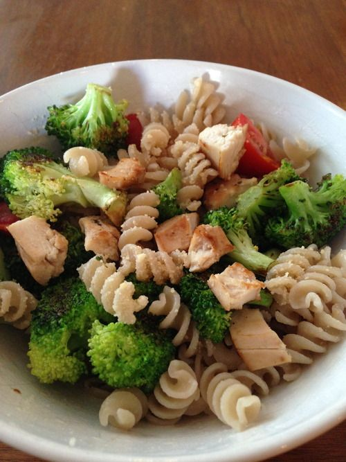 ... -Free Chicken, Broccoli and Tomato Pasta topped with parmesan cheese
