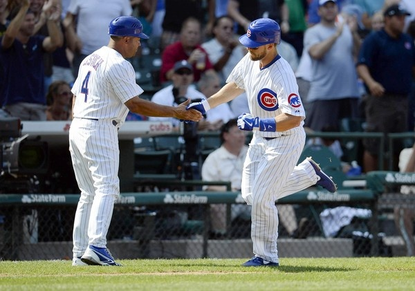 Brett Jackson is congratulated by third base coach Pat Listach after hitting his homer against the Rockies on Friday