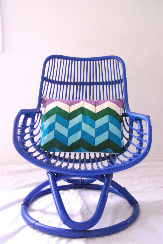 A vintage cane chair goes electric in bold blue.