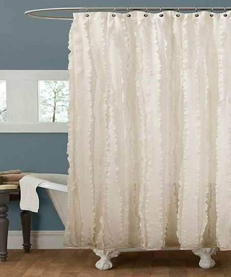 Ivory Cascading Ruffle Shower Curtain. Could be used as a backdrop.