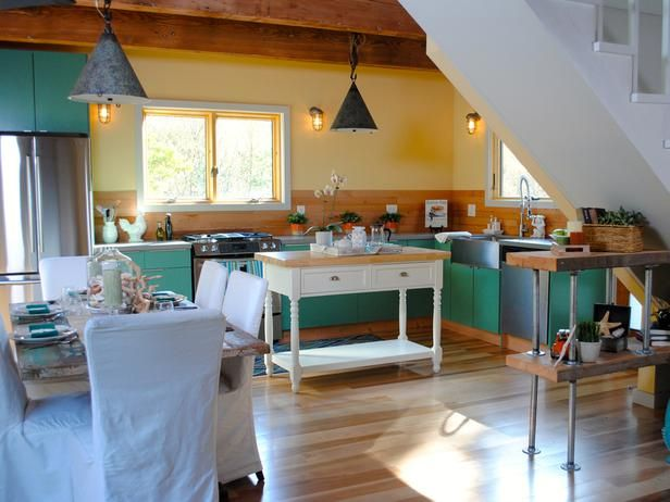 As seen on HGTV's Vacation House for Free:  The bulk of this renovation went into making the kitchen an enjoyable place to cook, relax and entertain. Clean lines and quartz countertops modernize the space while new hickory flooring and bright cabinet color add a beachy cottage feel.