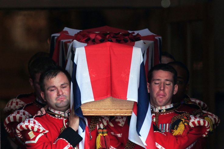 Sad goodbye soldiers carried the coffin of british soldier lee rigby