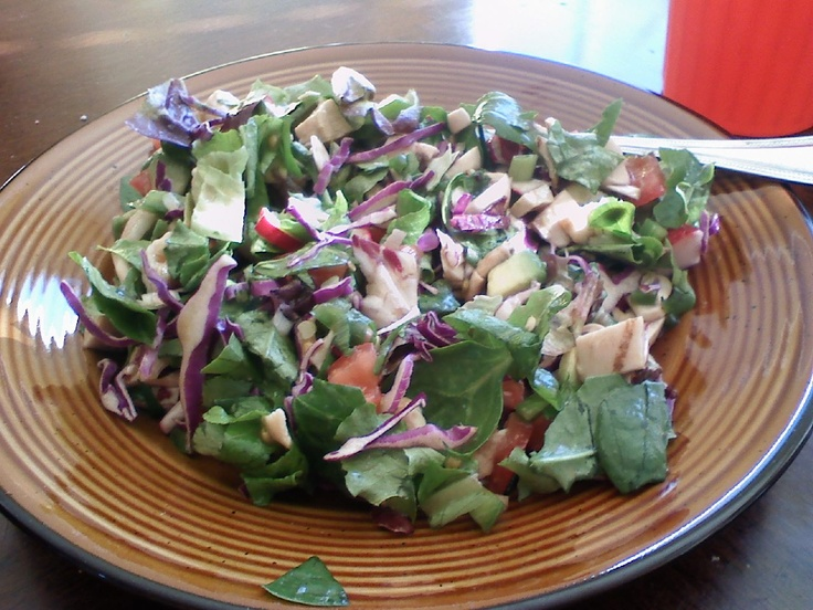 3 oz grilled chicken breast  1/4 avocado  1 plum tomato chopped  3 cups chopped lettuce  1/2 cup purple cabbage  3 mushrooms chopped  2 radishes chopped  2 green onions chopped  1/4 cup bell pepper chopped  3 tbsp Newmans Own lowfat sesame ginger   Toss well. ENJOY!!