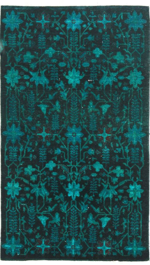 Overdyed teal rug