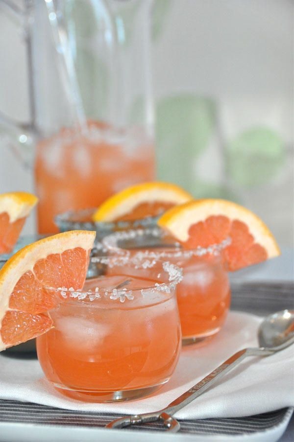 ... red grapefruit juice served on the rocks with a grapefruit garnish