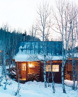 another snowy cabin with lights (Photo By: James Carriere Photography)