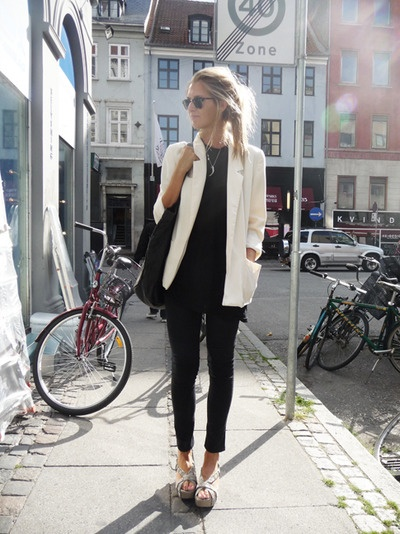 Black top, black pants, white jacket.
