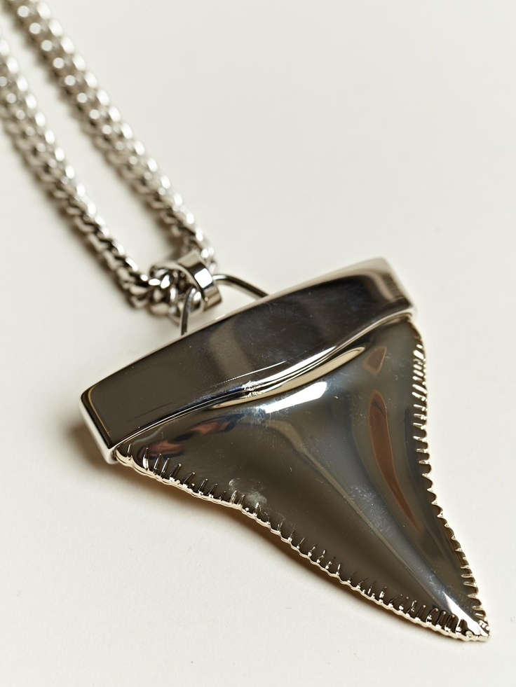 givenchy s shark tooth necklace prioritize
