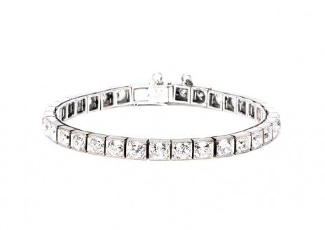 """This  stunning 1930's Art Deco platinum and diamond straight line bracelet is vintage Cartier and features approximately 15 carats of diamonds judged to have SI1-2 clarity and F-G color. It is stamped """"Cartier N.Y."""" and comes with the original box."""
