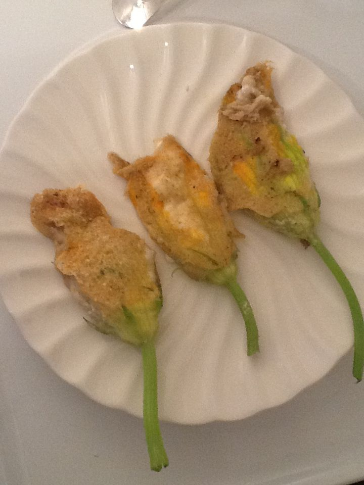 Pan fried zucchini flowers stuffed with goat cheese and mint