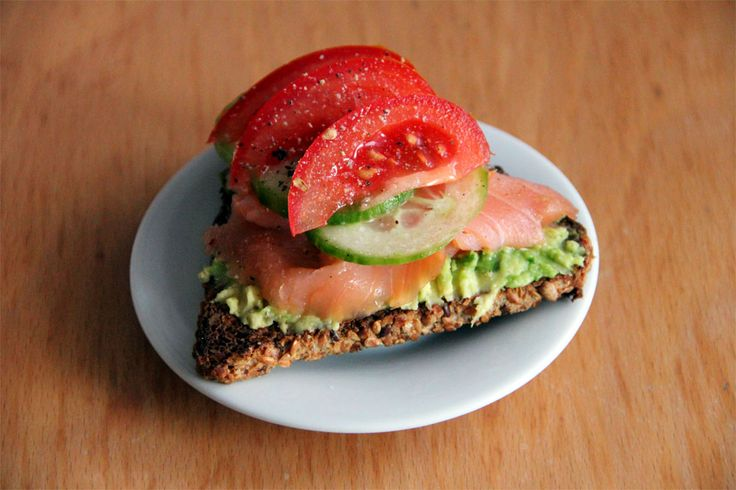 toasted whole grain bread with mashed avocado, smoked salmon, cucumber ...