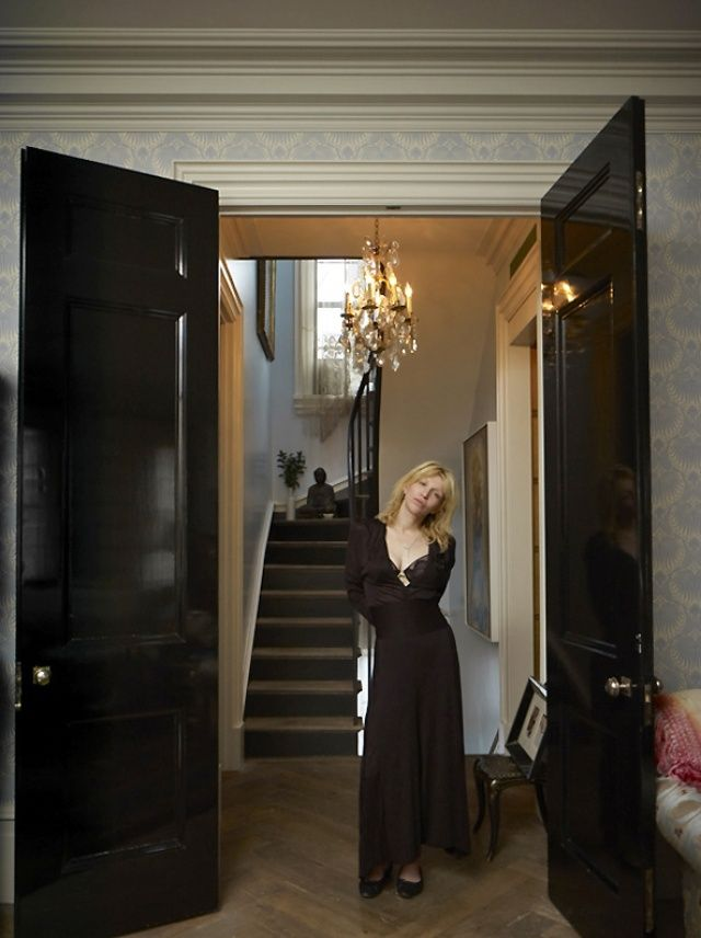 "From xojane.com: ""Courtney Love in the grand entry way [of her West Village NYC townhouse]?which leads from the living area to an upstairs bedroom. All clothing, Chanel."