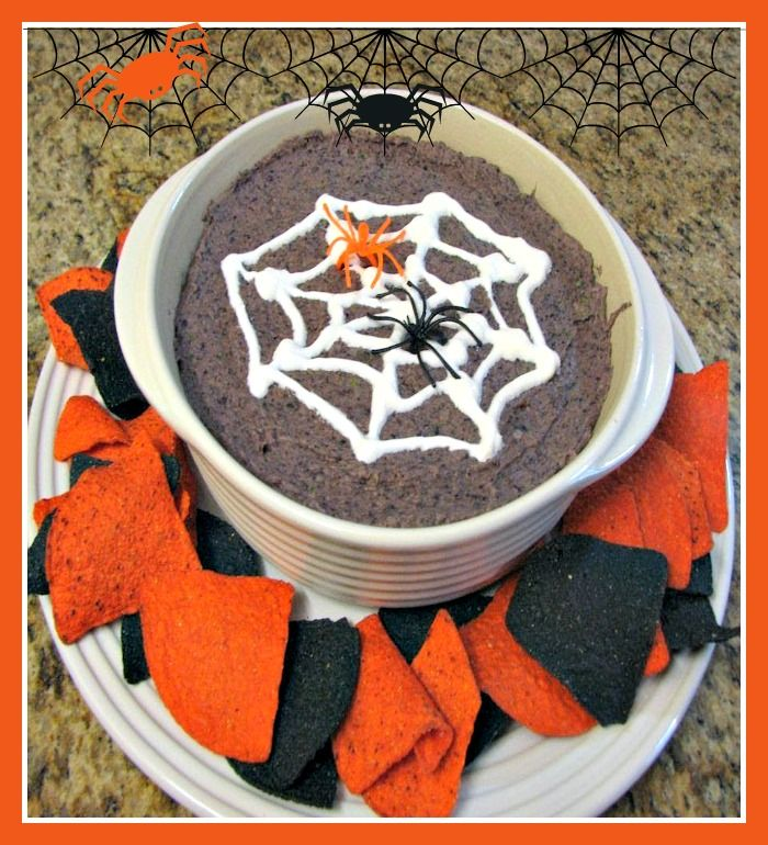 Learn how to make a delicious, healthy black bean dip perfect for Halloween by piping a spider web design on the dip with sour cream! // #SpiderWeb #BlackBean #Dip #halloween