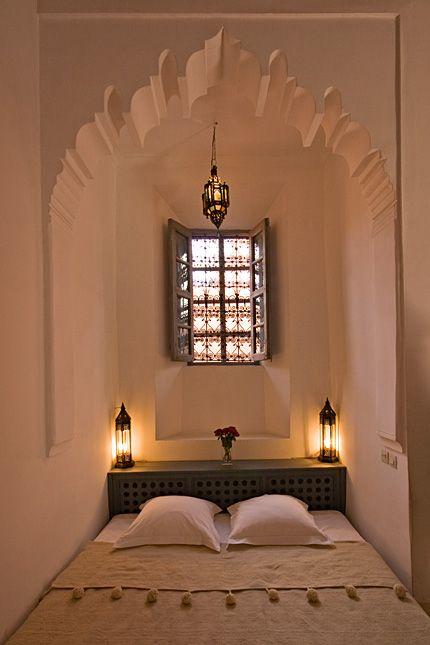 .Pale, serene Moroccan bedroom.
