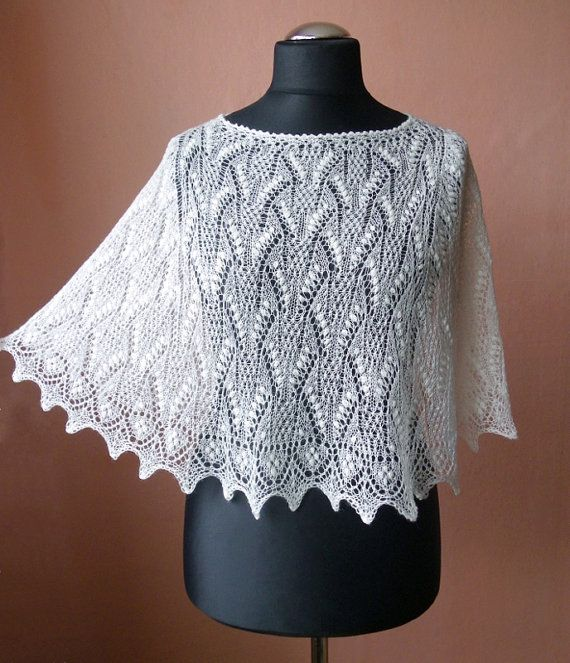 Natural white, creamy white hand knitted lace poncho from fine wool w?