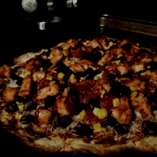 Homemade BBQ pizza - chicken, onions, red and yellow peppers ...