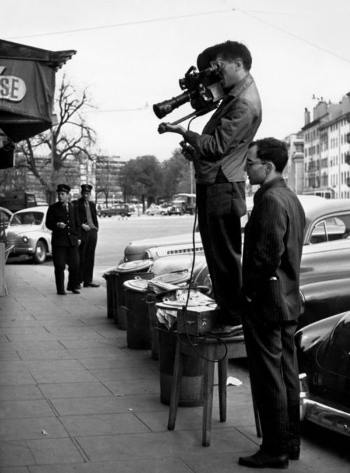 """Jean Luc Godard and Raoul Coutard on the set of """"À bout de souffle"""" by Raymond Cauchetier"""