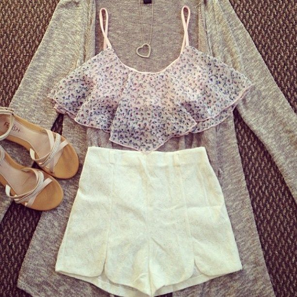 Cardigan, flowy cropped top, high waisted white shorts, sandals.