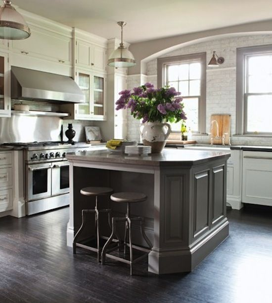 dark grey kitchen island, painted brick walls, arch over windows