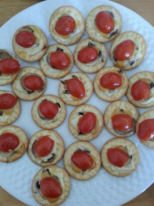 ... cracker, topped with mushroom, honey mustard and a half grape tomato