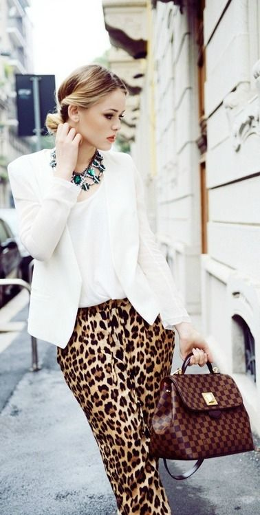 White coat with leopard skirt giving a cool look