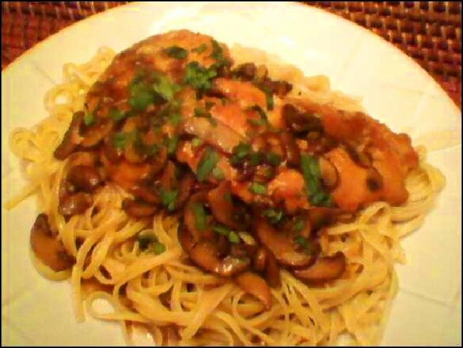Chicken with mushrooms and sweet Marsala wine sauce over linguine ...