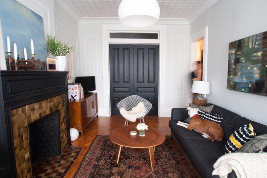 dark sofa, doors, fireplace