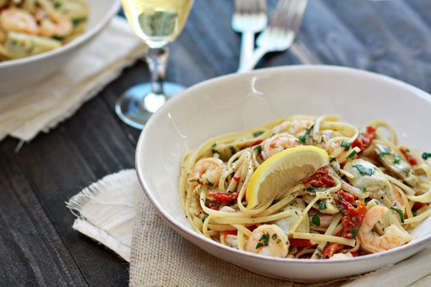 Shrimp scampi with sun-dried tomatoes and artichokes over pasta