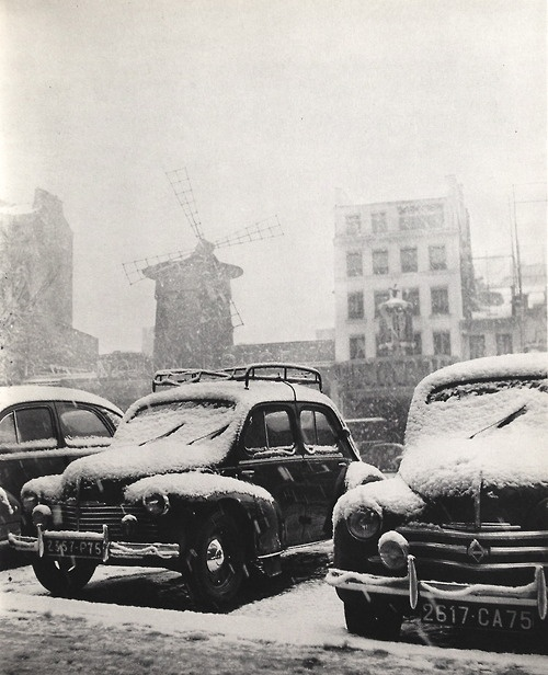 Moulin Rouge (background) Paris, 1950s. Photograph by René Maltête.