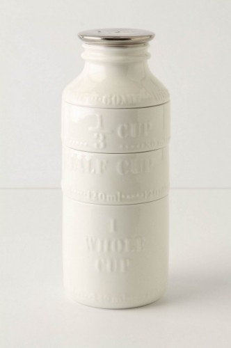 Measuring cups stack to create milk canister.