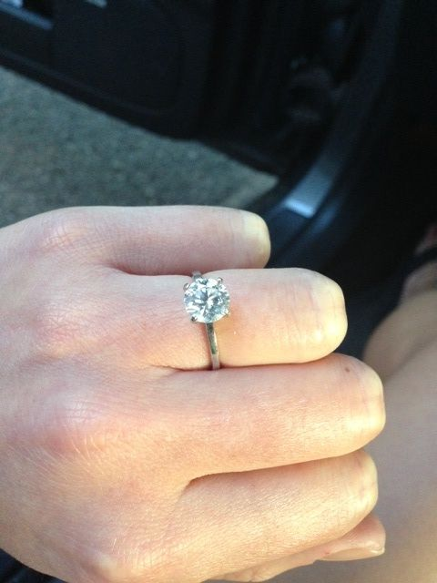 Round brilliant diamond solitaire thin band engagement ring