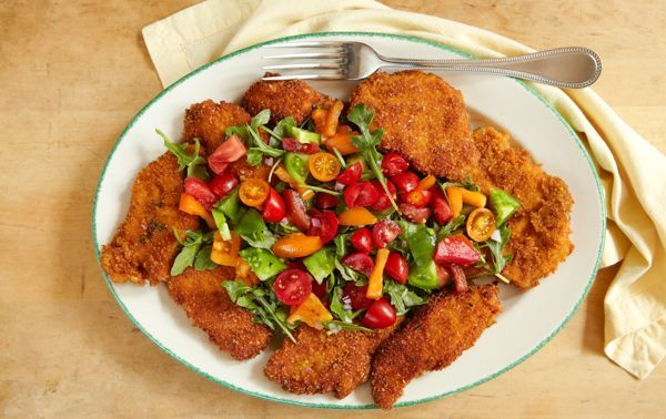 ... Chicken Milanese topped with fresh arugula and summer tomato salad