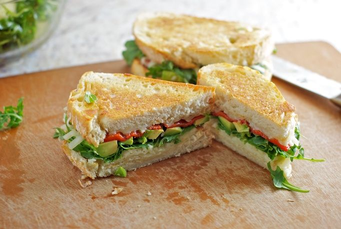 Grilled Cheese with Avocado, Arugula and Roasted Red Pepper.