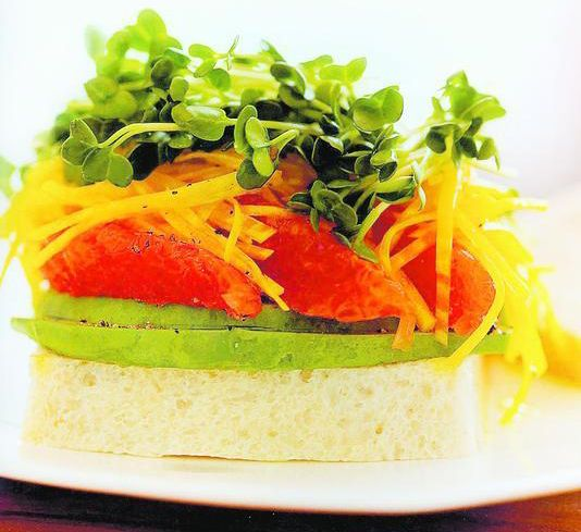 Yellow beet sandwich with avocado, grapefruit, and radish sprouts.