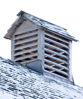 On top of the roof sit two cupolas. These allow light and air to enter the barn