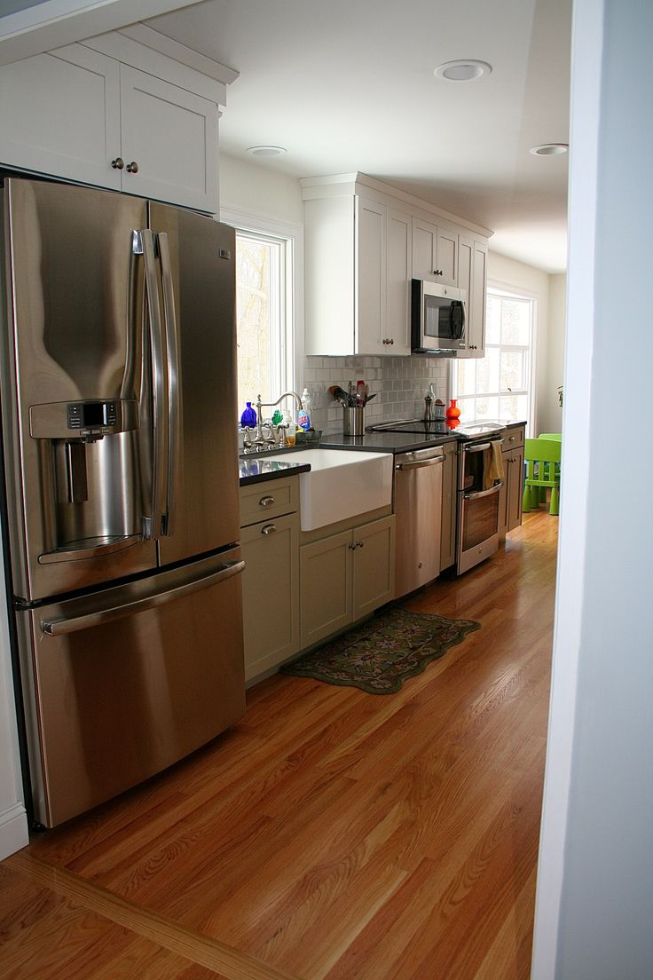 New England Kitchen featuring white and celadon kitchens cabinets