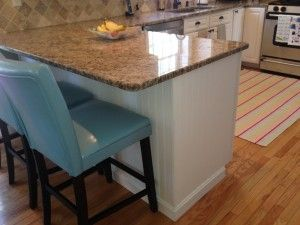 Painted kitchen cabinets in Sherwin Williams Downy.