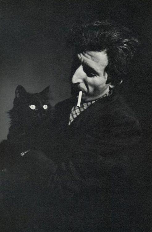 Carl Mydans, Gjon Mili and his cat Blackie, 1944