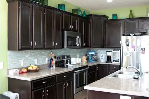 Dark cabinets with lime green walls