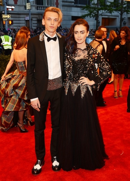 Lily Collins in Moschino with Jamie Campbell Bower at the Met Gala 2013