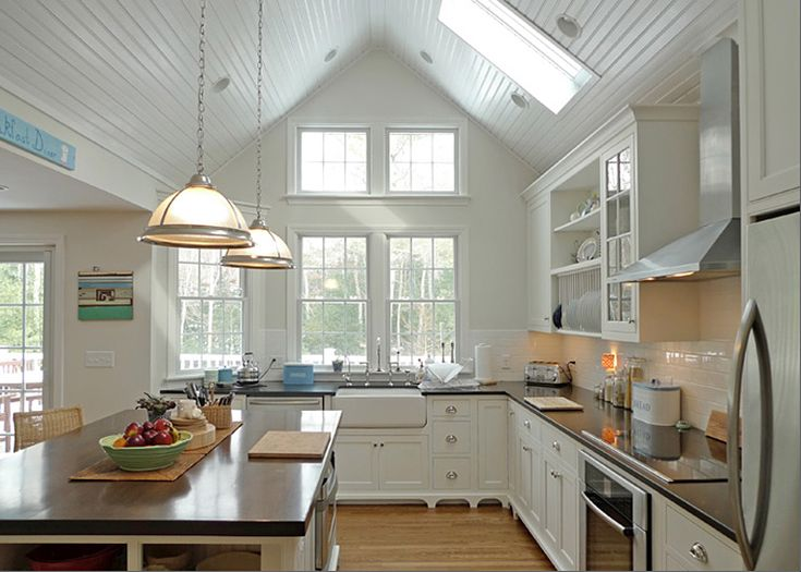 White kitchen, love the vaulted ceiling and windows. The sink is looking out to backyard, but still has view of family.