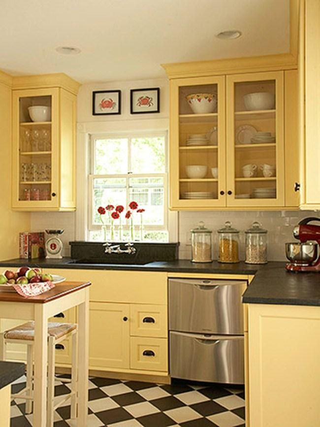 pretty yellow kitchen with black and white checkered floor